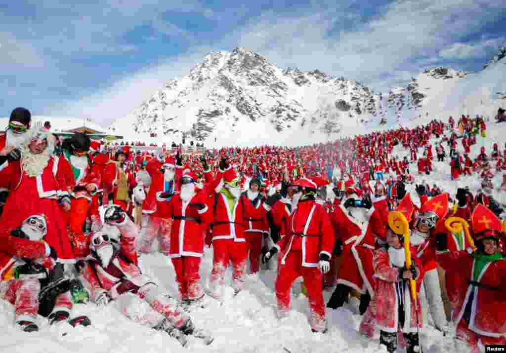 People dressed as Santa Claus enjoy the snow during the Saint Nicholas Day at the Alpine ski resort of Verbier, Switzerland, Dec. 2, 2017.