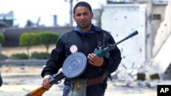 A rebel fighter takes position in the frontline at Tripoli street in Misrata. Tripoli street is the scene of some of the heaviest fighting between rebels and Gaddafi forces, April 21, 2011