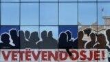 Kosovo, Pristina, giant poster bearing the name of the party Vetevendosje,