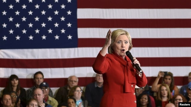 FILE - Democratic presidential candidate Hillary Clinton speaks at a campaign rally in Las Vegas, Nevada, Feb. 14, 2016. The judge's order gives Judicial Watch and the State Department until April 12 to come up with a plan for moving forward with the depositions.