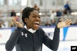 Maame Biney reacts during a medal ceremony after winning the women's 500-meter race during the U.S. Olympic short track speedskating trials, Dec. 16, 2017, in Kearns, Utah.