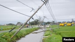 Power poles damaged due to strong winds caused by Typhoon Goni are seen in Kamimine town, Saga Prefecture, Japan, in this photo taken by Kyodo August 25, 2015.