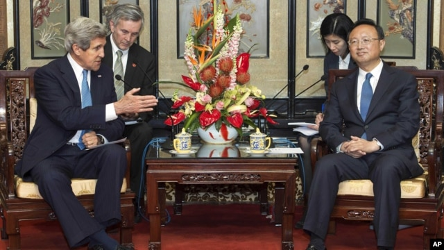 U.S. Secretary of State John Kerry, left, speaks to Chinese State Councilor Yang Jiechi during their meeting in the Diaoyutai State Guesthouse, in Beijing, Apr. 13. 2013.