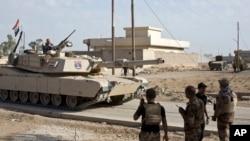 Pasukan khusus Irak memasuki Bazwaya, sekitar 8 kilometer dari pusat kota Mosul, Senin (31/10).