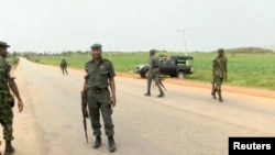 Des officiers de sécurité dans l'Etat du Plateau, au Nigeria, le 25 juin 2018.