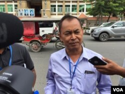 Yi Soksan, ADHOC official tells journalist after left the municipal court on August 27, 2018.