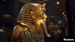 The mask of King Tutankhamun, which was found to have been damaged and glued back together, is seen at the Egyptian Museum in Cairo, Jan. 24, 2015.