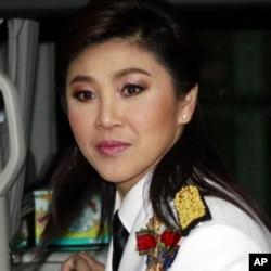 បេក្ខជនារីនាយករដ្ឋមន្ត្រីជាប់ឆ្នោតថ្មី Yingluck Shinawatra ពីគណបក្សភឿថៃមកចូលរួមនៅពិធីបើកនីតិកាលសភាថ្មីកាលពីថ្ងៃទី១ខែកក្កដា។