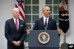 President Obama, with Vice President Biden, promises a smooth transition.