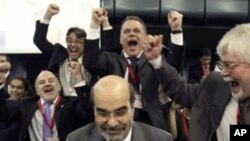 Newly elected Food and Agriculture Organization Director-General, Jose Graziano da Silva of Brazil, center, is cheered by delegates after being elected at FAO's Headquarters in Rome, Sunday, June 26, 2011.