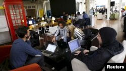 """Participants of the """"Start Up Chile"""" program work at their headquarters in Santiago, Aug. 10, 2015."""