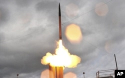 FILE - A THAAD missile test launch.