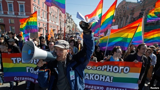 Participants march and shout slogans during a protest by gay rights activists in St. Petersburg May 1, 2013.