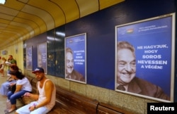 "Hungarian government posters portraying financier George Soros and saying ""Let's not allow Soros to have the last laugh!"" are seen at an underground stop in Budapest, Hungary, July 11, 2017."