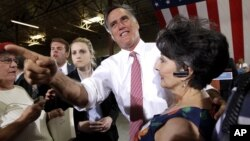 Republican presidential candidate, former Massachusetts Gov. Mitt Romney, greets supporters after speaking at a campaign event at the Somers Furniture warehouse in Las Vegas, Nevada, May 29, 2012.