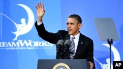 President Barack Obama waves after speaking at the DreamWorks Animation studio, Nov. 26, 2013, in Glendale, California.