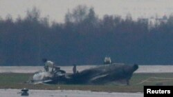 The wreckage of what is believed to be Christophe de Margerie's Dassault Falcon jet is seen at Moscow's Vnukovo airport, Oct. 21, 2014.
