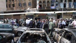 Burnt out cars at site of blast in Damascus June 28, 2012