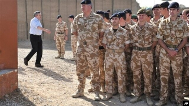 British Prime Minister Gordon Brown (L) arrives to greet soldiers at Lashkar Gah base, Helmand Province, Afghanistan, 06 Mar 2010