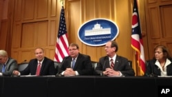 FILE - Ohio Senate President Larry Obhof, center, joins Republican leaders to introduce Senate budget changes Monday, June 12, 2017, at the Ohio Statehouse in Columbus, Ohio.
