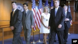 House Speaker John Boehner of Ohio, second from right, and fellow House Republicans leave a news conference on Capitol Hill in Washington, Thursday, July 28, 2011. From left are, Rep. Jeb Hensarling, R-Texas, House Majority Leader Eric Cantor of Va., Rep.