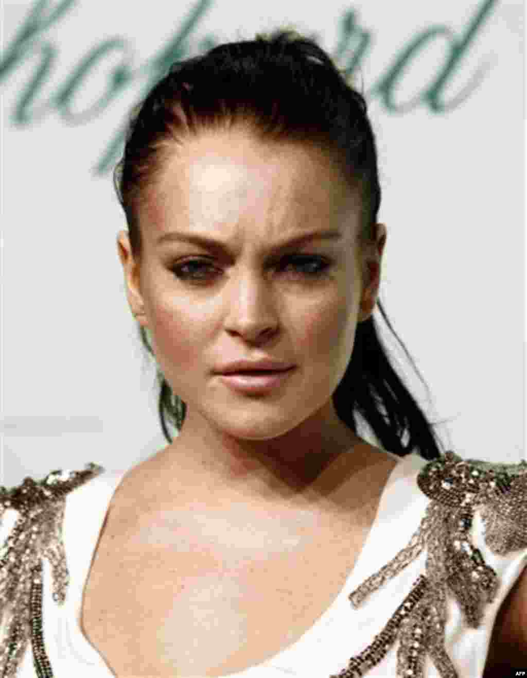 FILE - In this May 17, 2010 file photo, Lindsay Lohan arrives for an event during the 63rd international film festival, in Cannes, France. A judge on Thursday, May 20, 2010 issued a warrant for Lohan's arrest after the actress missed a mandatory hearing.