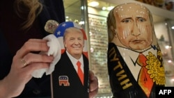 An employee polishes traditional Russian wooden nesting dolls depicting Donald Trump (L), U.S. president-elect at the time, and Russian President Vladimir Putin at a gift shop in central Moscow, Russia, Jan. 16, 2017. Russians have largely greeted Donald Trump's ascendancy to the White House with high hopes for a new era of improved relations.
