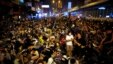 Pro-democracy protesters sit on a street as they block an area of the Mongkok shopping district of Hong Kong Oct. 20, 2014.
