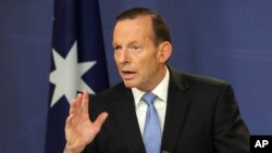 FILE - Prime Minister Tony Abbott says Australia is prepared to join airstrikes against the Islamic State.