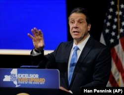 In this January 11, 2017 photo, New York Governor Andrew Cuomo gives a speech about the Excelsior Scholarship at one of his state of the state addresses at State University of New York in Albany, New York.