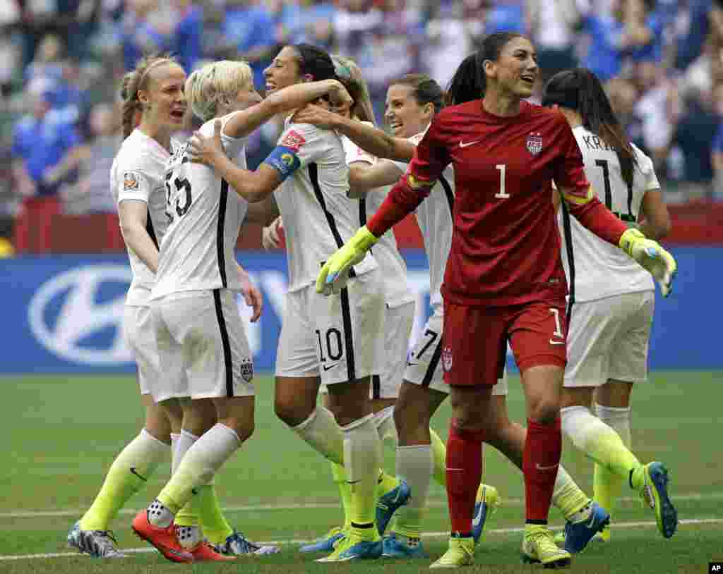 United States' Carli Lloyd (third from left) celebrates with teammates, including goalkeeper Hope Solo (1), after Lloyd scored her third goal against Japan during the first half of the Women's World Cup soccer championship in Vancouver, July 5, 2015.