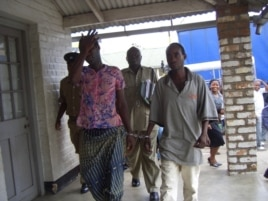 Tiwonge Chimbalanga and Steven Monjeza are taken into custody after celebrating their engagement, December 2009 (photo by Lameck Masina)