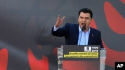 Albania's main opposition Democratic Party leader Lulzim Basha speaks at an anti-government rally in downtown Tirana, Dec. 8, 2015.