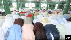 Nigeria Muslims offer prayers during Eid al-Adha prayers to mark the end of the holy month of Hajji.