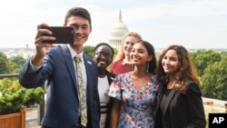 The 2017 Class of National Student Poets, from left, Ben Lee, Juliet Lubwama, Annie Castillo, Kinsale Hueston, and Camila Sanmiguel celebrate with a selfie picture on the top of the Library of Congress on Thursday, Aug. 31, 2017, in Washington. (Kevin Wolf/AP Images for Alliance for Young Artists & Writers)
