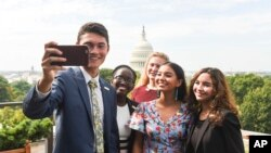 The newly-appointed 2017 Class of National Student Poets, from left, Ben Lee, Juliet Lubwama, Annie Castillo, Kinsale Hueston, and Camila Sanmiguel celebrate with a selfie on the rooftop balcony at the Library of Congress on Thursday, Aug. 31, 2017.