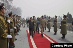 In this picture released by Pakistan's army, General Raheel Sharif is seen arriving at the Presidential palace in Kabul.