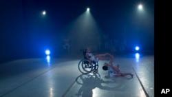 Dancer Sendoa Quijada performs in his wheelchair in the contemporary dance production Ubuntu, at the Teresa Carreno Theater in Caracas, Venezuela, Dec. 4, 2018.