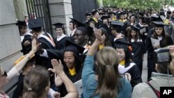 Friends and family greet students in the graduating class of 2012 at Princeton University following commencement ceremonies in Princeton, New Jersey, on June 5. More than 1,200 undergraduates were awarded degrees.