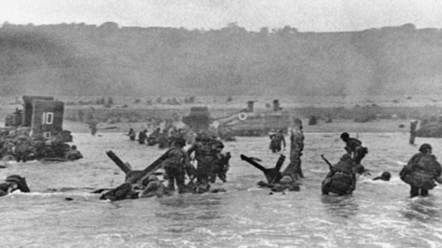 Some of the first troops to hit the beach at Normandy, France, on June 6, 1944