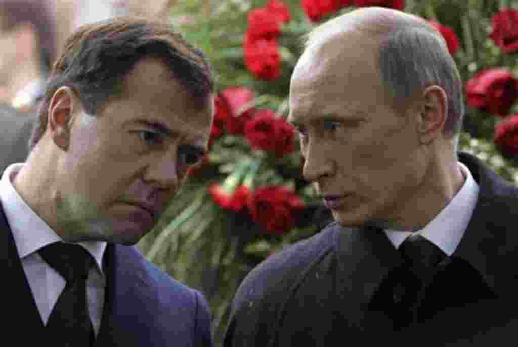 Russian President Dmitry Medvedev, left, and Prime Minister Vladimir Putin attend funeral of former Russian Prime Minister Viktor Chernomyrdin at Novodevichy Cemetery in Moscow, Russia, Friday, Nov. 5, 2010. Viktor Chernomyrdin, who served as Russia's pri