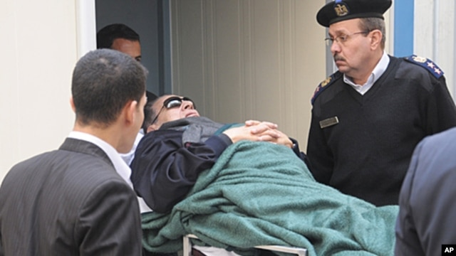 Former Egyptian president Hosni Mubarak is wheeled into a court house in Cairo, Egypt. The trial of Hosni Mubarak has resumed amid speculation that a recent acquittal of policemen tried for killing Egyptian protesters could be a prelude to the dismissal o