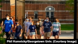 Georgetown University students walk through campus during a summer program in June 2021.