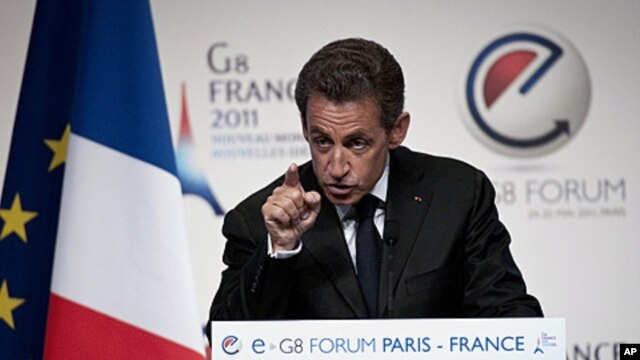 France's President Nicolas Sarkozy gestures, during a e-G8 conference, gathering Internet and information technologies leaders and experts,  in Paris, May 24, 2011.