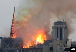 Flames rise from NoFlames rise from Notre Dame cathedral as it burns in Paris, Monday, April 15, 2019. Its tall, narrow spire later collapsed.