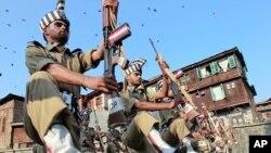 Policemen take part in Kashmir Martyrs Day ceremonies at the Martyrs graveyard in Srinagar July 13, 2011