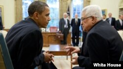 President Barack Obama and President Mahmoud Abbas of the Palestinian Authority talk following their statement to the press in the Oval Office, June 9, 2010. (Official White House Photo by Pete Souza)