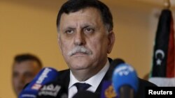 FILE - Libyan prime minister-designate under a proposed national unity government, Fayez Saraj, attends a news conference in Tunis, Tunisia, Jan. 8, 2016.