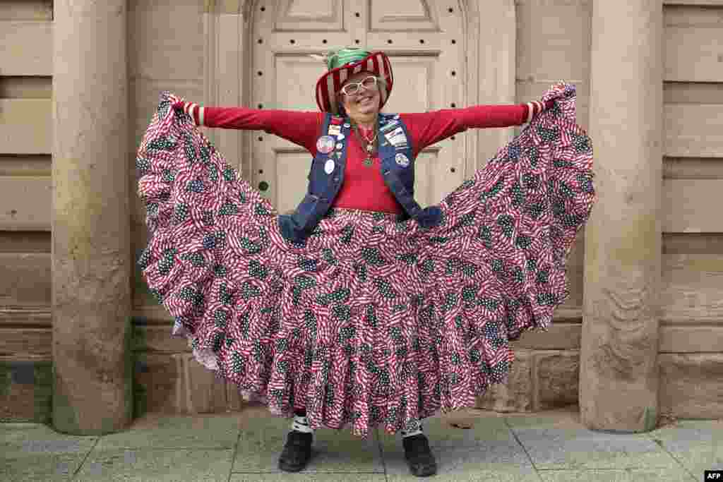 Susan Reneau poses for a portrait as she shows off her patriotic outfit near Constitution Avenue in Washington, DC.
