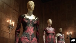 "Gowns on display in the ""Romantic Nationalism"" gallery at the Metropolitan Museum of Art"